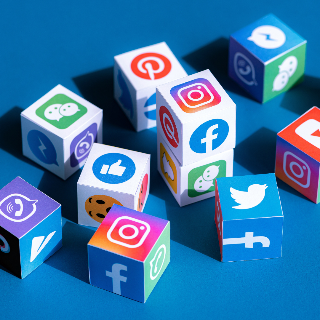 social media marketing graphic with social media logos on a bunch of dice